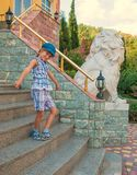 Child on the stairs of house Royalty Free Stock Images