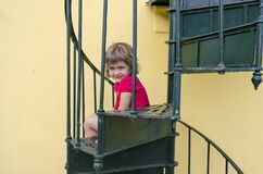 Child on stairs smiling