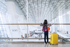 Child standing in the airport terminal Stock Photo