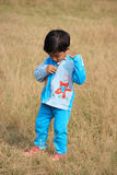 The child. Child is standing in the field Stock Images