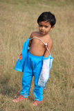 The child. Child is standing in the field Royalty Free Stock Photo
