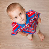 Child standing on the floor Royalty Free Stock Images