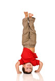 Child standing on his arms. Yoga Stock Images