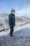 Child standing on ice Royalty Free Stock Images