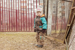 Child standing near the fence Royalty Free Stock Images