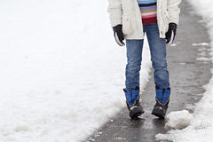Child standing in a snowy street Stock Photography