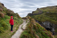 Child standing on a Tintagel bay North Cornwall coast, England Stock Image