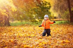 Child standing with umbrella in beautiful autumnal day stock image