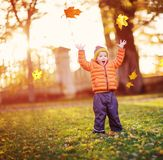 Child standing with umbrella in beautiful autumnal day royalty free stock photo