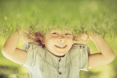 Child standing upside down Stock Images