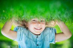 Child standing upside down Royalty Free Stock Photos