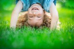 Child standing upside down Royalty Free Stock Images