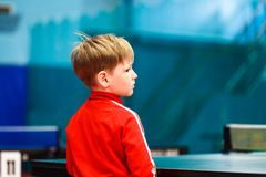 The child stands in the gym back royalty free stock image