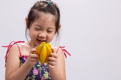 Child with Star Apple / Child Holding Star Apple Background Royalty Free Stock Photos