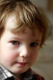 Child stares closely. Very attentive sight of the taken offence boy Royalty Free Stock Image