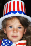 Child stars and stripes. Girl wearing hat and bow with American flag Royalty Free Stock Image
