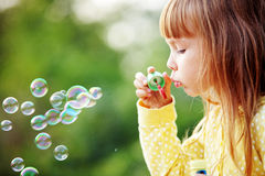 Child starting soap bubbles stock image