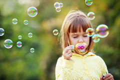 Child starting soap bubbles Royalty Free Stock Photos