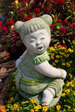 Child statue in the garden. Royalty Free Stock Photos