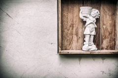 Child statue in a garden is carriyng a tray Stock Images