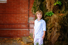 Child stays by the house in summer Stock Photography