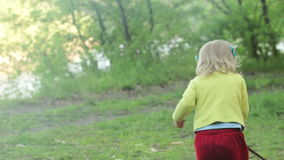 Child with stick picnic stock footage