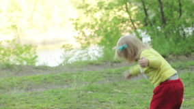 Child with stick playing stock video footage