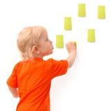 Child sticks paper sheets Stock Image