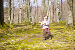 The child with the sticks to walk. royalty free stock photos