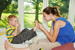Free Child Stifling Laughter Tickled Foot Stock Photo - 58174340