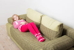 Child with stomach ache indoor Stock Photo