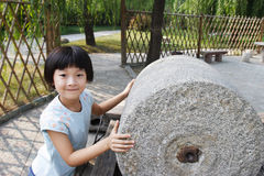 Child with stone roller Stock Photo