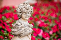 Child stone sculpture in garden Royalty Free Stock Photography