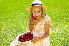 Child with strawberries Royalty Free Stock Image