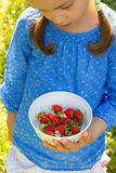 Child with strawberries Royalty Free Stock Photo