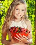 Child with strawberry Stock Photography