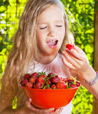 Child with strawberry Royalty Free Stock Photography