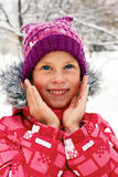 child in the street on the first day of winter. Stock Image