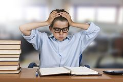 Child stressed the study. And books stock image