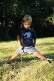 Child stretching body Stock Images