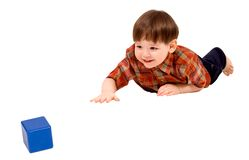 Child stretching to toy Royalty Free Stock Image