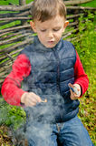 Child striking a match Royalty Free Stock Images