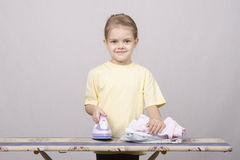 The child stroking things iron Stock Photography