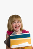 Child struggling with books Royalty Free Stock Photos