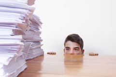 Child student on the desk. With stacked papers royalty free stock photo