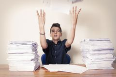 Child student on the desk. With stacked papers stock photography
