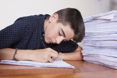 Child student on the desk. With stacked papers stock images