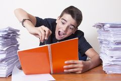 Child student on the desk. With stacked papers royalty free stock photos