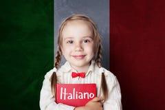 Child student learning italian language against flag. Of Italy royalty free stock photo