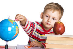 Child studies the globe Stock Photo